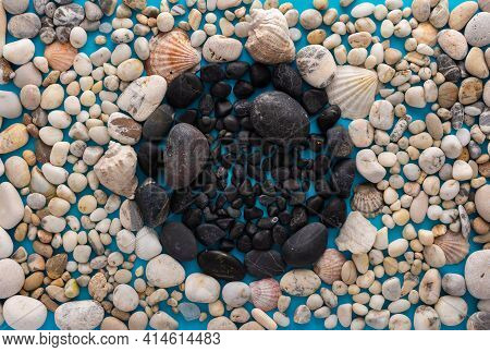 Sea Pebbles And Shells On A Blue Background