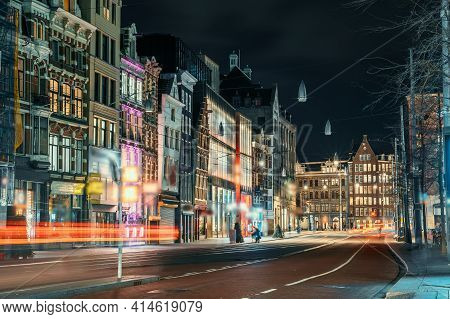 Night City View Of Amsterdam City, Street With Illuminated Buildings Of Old European City, Netherlan