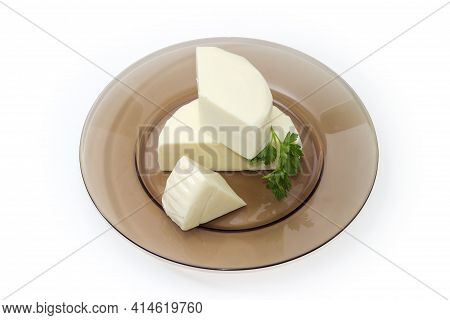 Pieces Of Fresh Mozzarella Cheese, That Was Soaked In Whey With Parsley Twig On Glass Dish On White