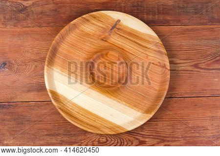 Empty Round Serving Dish With Sauce Boat In The Center Made With Natural Hardwood On An Old Rustic T