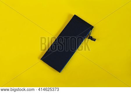 Swollen Lithium Ion Polymer Battery Inside A Mobile Phone On  Background.