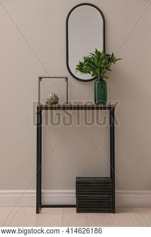 Console Table With Decor And Mirror On Light Wall In Hallway. Interior Design
