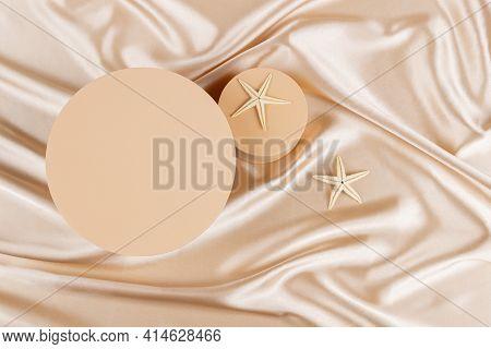 Geometric Platform Podium With Two Starfishes On Pastel Silk Satin Background. Blank Minimal Cylinde