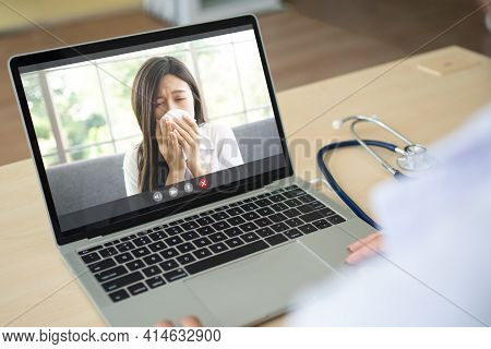 The Doctor Video Conference With A Sick Person With A Cold And Sneezing And Ask For Symptoms Of The