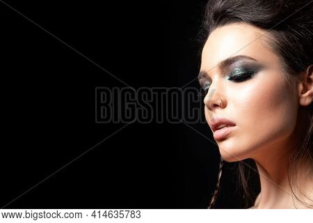 Portrait Of Young Beautiful Woman With Evening Make Up. Model Posing Over Black Background. Silver S