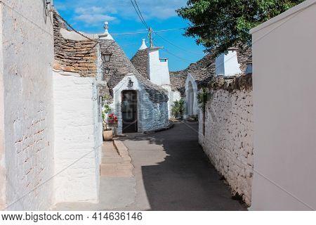Tradtional White Houses In Trulli Village, Alberobello, Italy.