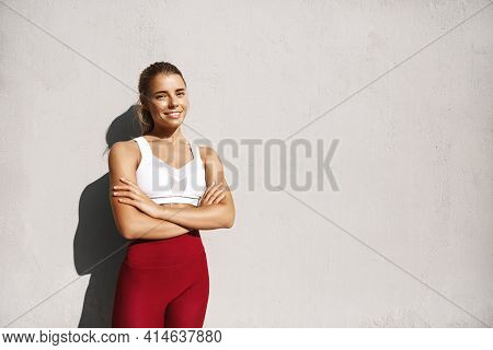Strong Fitness Woman Exercise On Fresh Air. Sportswoman Smiling After Good Workout, Training Outdoor