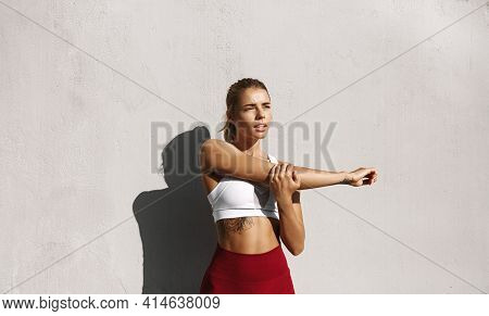 Workout On Sunny Summer Day. Fitness Girl Stretch Her Arm Before Jogging. Female Athlete Runner Prep