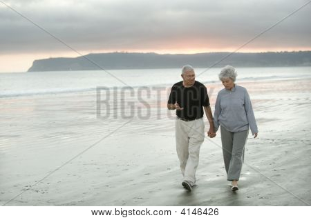 Seniors Walking The Beach