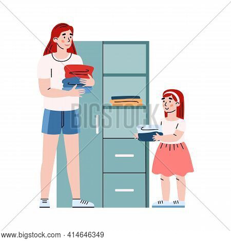 Daughter And Mother Doing Housework Putting Clean Clothes In Wardrobe Or Closet.
