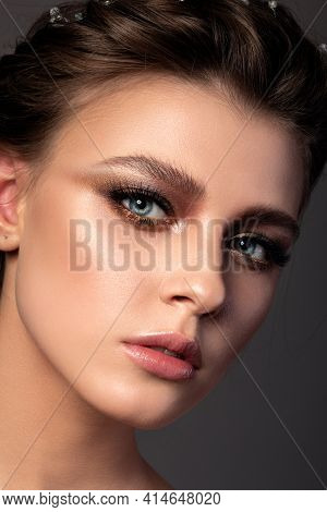 Close Up Beauty Portrait Of Young Woman With Beautiful Bronze Smokey Eyes Makeup