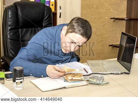 The Boss At His Desk Happily Counts The Money He Has Received. Counting The Lost. Business Man
