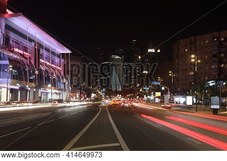 Night Photo Of The Urban City Street With Busy Highway And Neon Lights In Moscow, Russia