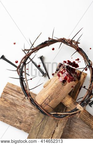 Old Wooden Cross, Hammer, Bloody Nails And Crown Of Thorns Isolated On White Background. Copy Space.