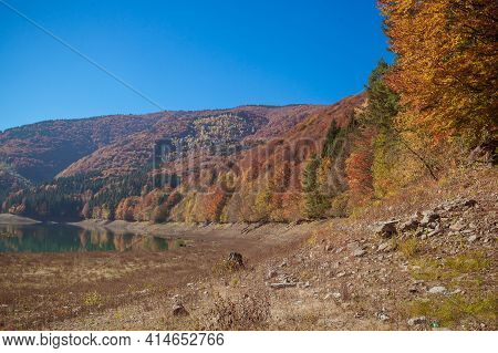 Amazing Autumn Landscape In The Mountains With River And Colorful Trees On Backdrop. Beautiful Autum
