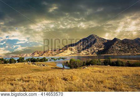The lake Kaweah is water reservoir on Kaweah river beneath Sierra Nevada mountains, California, USA. Brilliant sunset time