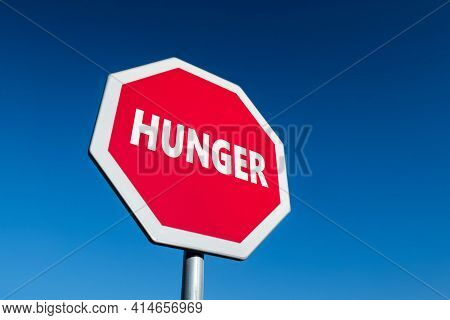 Stop Traffic Sign With Hunger Text To Prevent The Famine Situation In Poor Parts Of The World