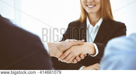 Business People Or Lawyers Shaking Hands Finishing Up A Meeting, Close-up. Negotiation And Handshake