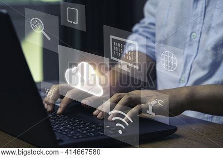 Virtual Cloud And Technology Icons , Businessman Using Laptop Computer To Control Operations Thru Cl