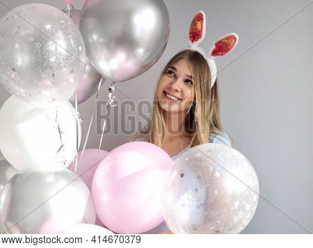 Happy Girl In Costume Bunny With Ears. Girl In Rabbit Costume Having Fun With Pink Balloons. Happy E
