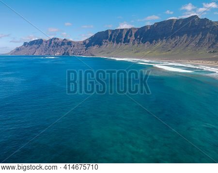Aerial View Of Famara Beach At Lanzarote On Canary Islands, Spain