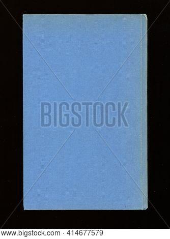 Old Book With Light Blue Hardback Cover Over Black Background