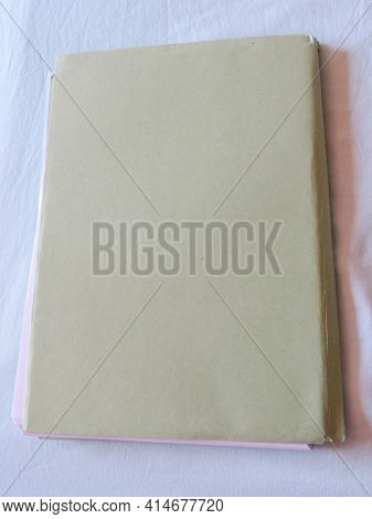 Office Paper Documents In A Folder On The Desk