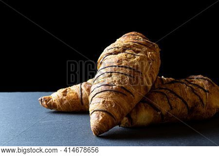 Croissant French. Fresh Pastry Bread Or French Breakfast Croissants With Chocolate In Bakery On Blac