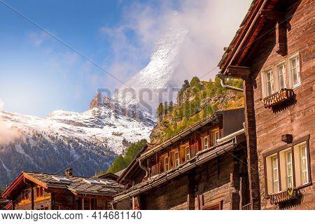 Matterhorn Snow Mount Close-up And Zermatt Alpine Houses, Switzerland, Swiss Alps