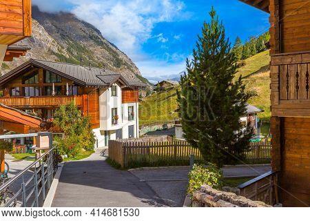 Traditional Wooden Houses In Zermatt, Alpine Village Summer Street View, Switzerland, Swiss Alps Mou