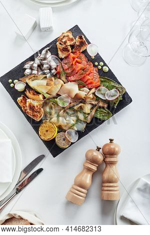 Seafood Platter. Assorted Delicious Seafood With Vegetables. White Background