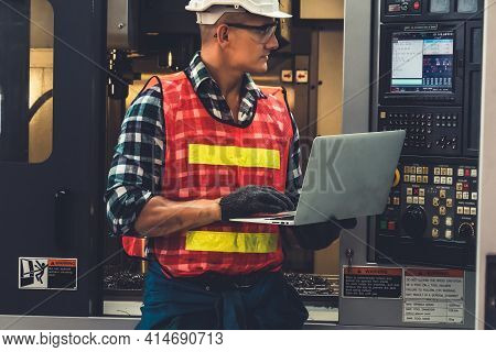 Smart Factory Worker Or Engineer Do Machine Job In A Manufacturing Workshop . Industry And Engineeri