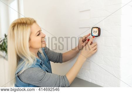 Smart Home Digital Thermostat Touch Screen Woman Touching Touchscreen To Adjust Temperature Of Heati