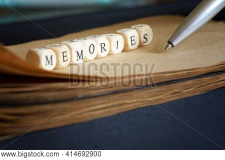 A Ballpoint Pen Writes Memories In An Eco-friendly Notebook. Concept For Nostalgia, Life Story And M