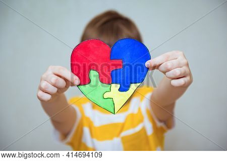 Kid Boy Hands Holding Drawing Of A Heart, Child Mental Health Concept, World Autism Awareness Day, T