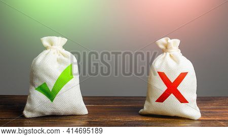 Two Bags With A Green Check Mark And A Red Cross. Risk Planning. Advantages And Disadvantages. Usefu