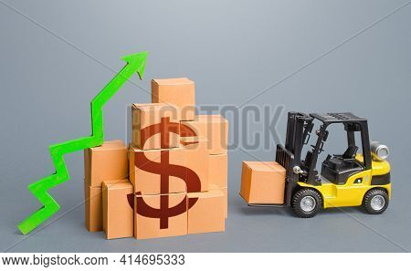 Forklift Near A Stack Of Dollar Boxes With A Green Up Arrow. Sales Growth Concept. Production And Fr