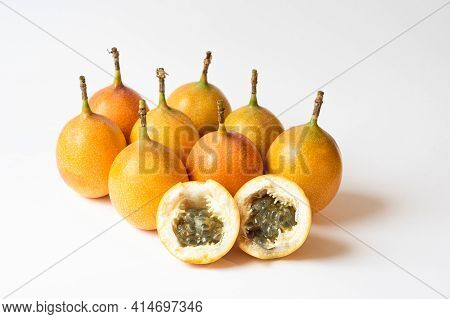 Granadilla Or Yellow Passion Fruit Isolated On White Background. Grenadia Passion Fruit Cut In Half