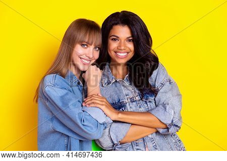 Portrait Of Gorgeous Friendly Girls Dark Skin Touch Arm Look Camera Beaming Smile Isolated On Yellow