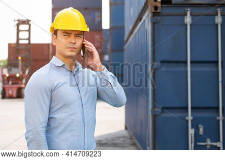 Caucasian Men Freight Supervisor Inspect The Condition Of All Containers Shipment By Using Tablet To