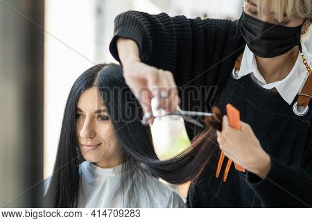 Caucasian Women With Hair Stylish While Do Hair Cut And Wearing Surgical Face Mask While Styling Hai