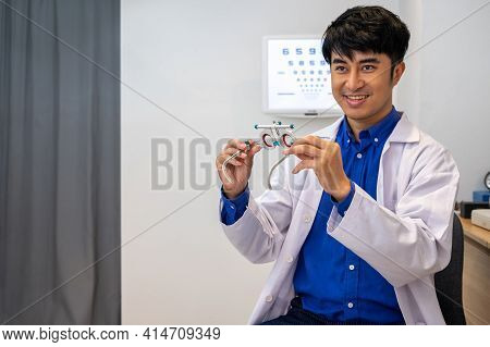Selective Focus At Optometry Trail Frame. Asian Doctor Optometrist Using Trail Glasses Equipment To