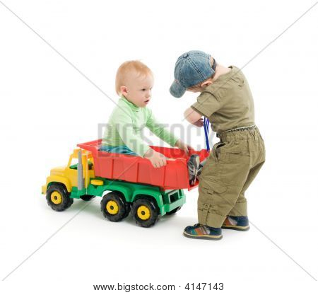 Two Little Boys Play With Toy Truck