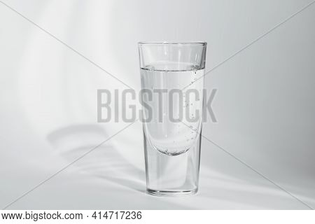 Glass Of Clean Mineral Sparkling Water On A White Background