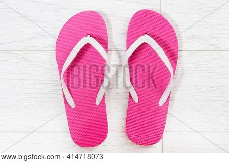 Pink Flip-flops On A White Wooden Background Close Up