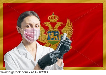 Girl Doctor Prepares Vaccination Against The Background Of The Montenegro Flag. Vaccination Concept