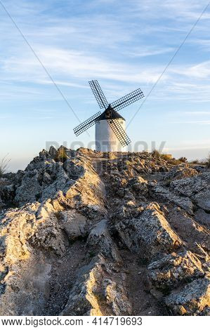 A Whitewashed Windmill In La Mancha In Warm Evening Light