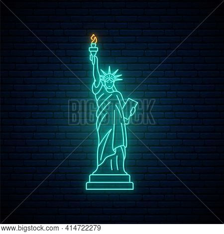 Neon Statue Of Liberty, Famous New York Landmark. Glowing Statue Of Liberty Icon On Brick Wall Backg