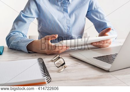 Business Lady Sitting At Desk And Using Tablet Computer. Corporate Office Workplace With Laptop. Bus