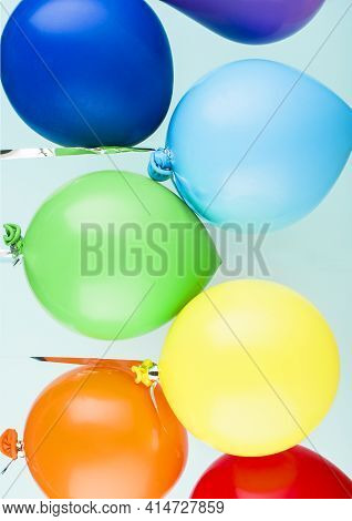 Small Inflatable Balls Of Rainbow Colors Hang On A Ribbon. Holiday Content. Art Concept